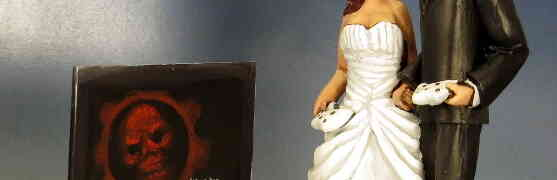 Another Geek Wedding Cake Topper: Families that Shoot Locusts Together...