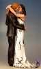 topper kissing black and white dress