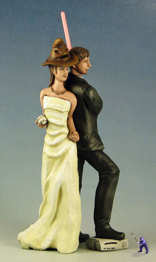 harry potter star wars wedding cake topper go with weapons you re familiar with garden studios 15100